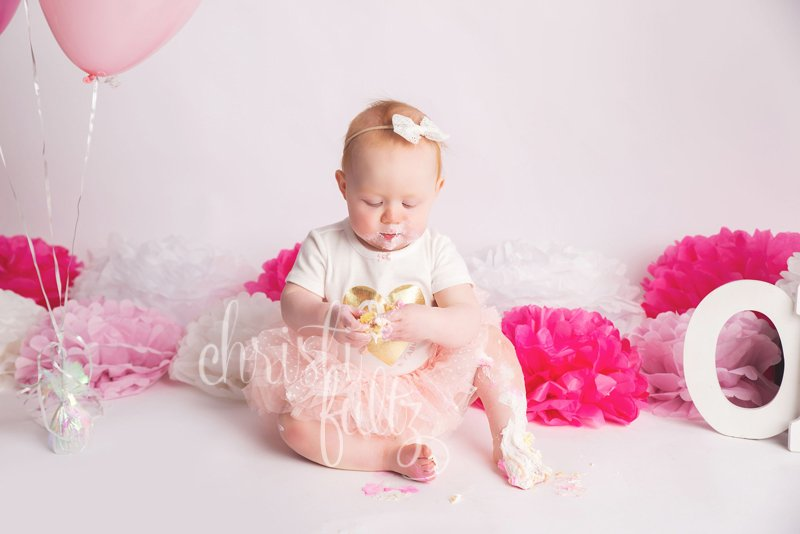 baby girl first birthday pictures pink cake smash